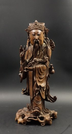 A Chinese Boxwood Carved Figure