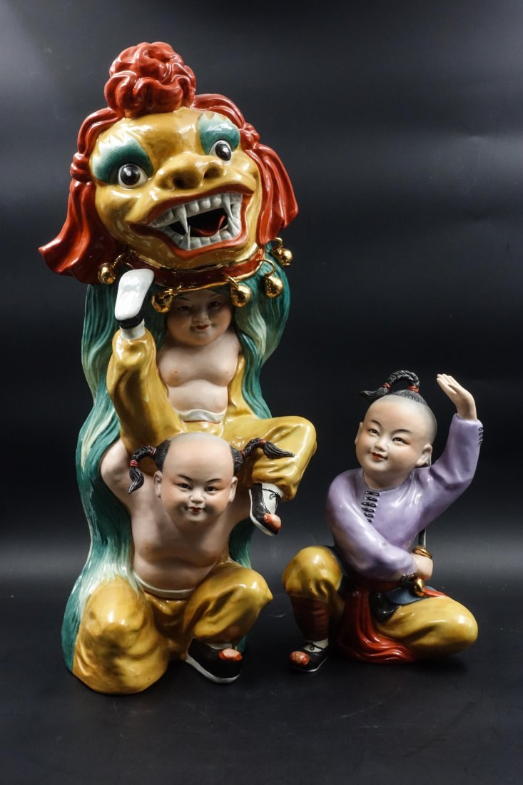 CHINESE PORCELAIN FIGURE OF BOY AND FOOLION