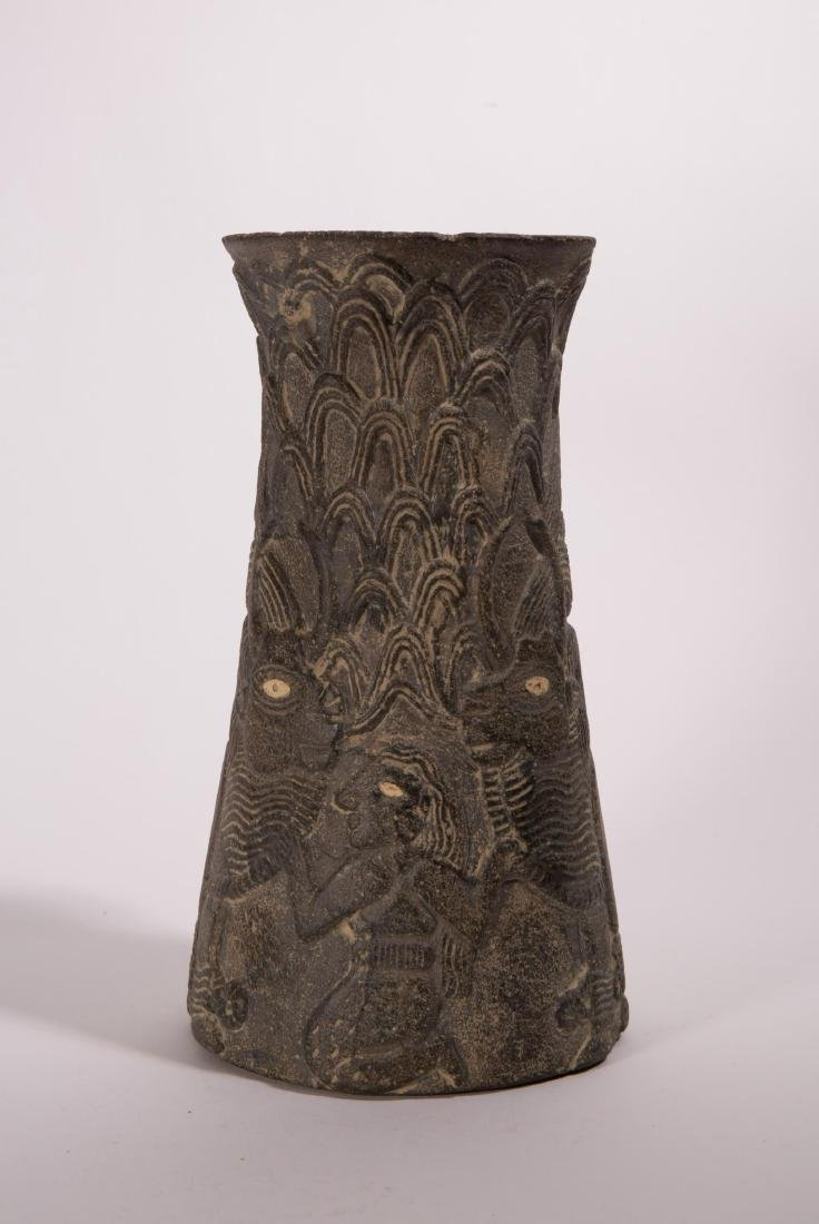 NEAR EASTERN STONE CARVED VASE WITH ANIMALS AND FI