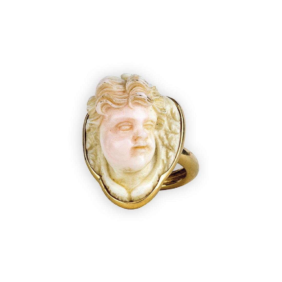 Ring with an angel's head in pink coral