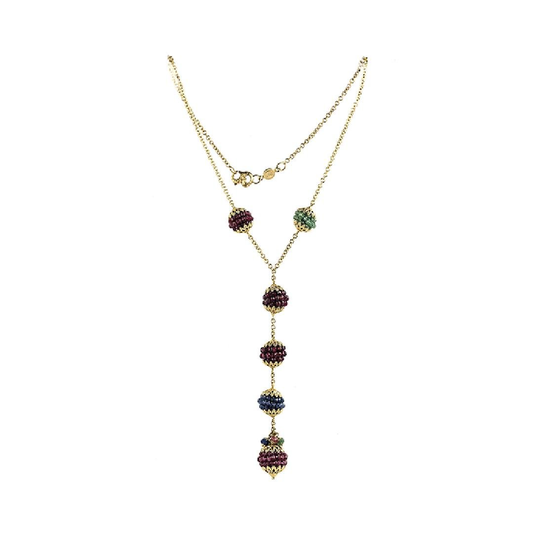 Necklace with spheres of rubies and emerald