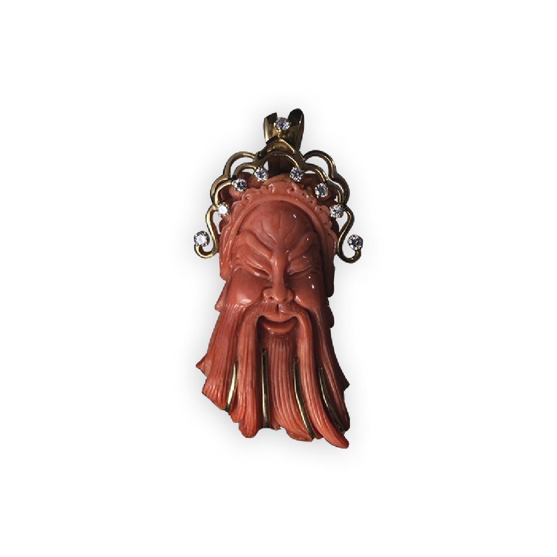 Pendant representing Confucius in coral