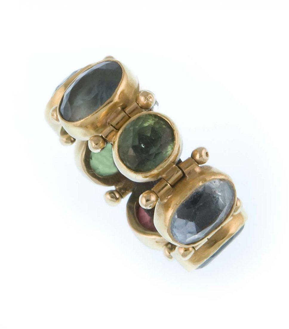 A ring with seven semi-precious stones