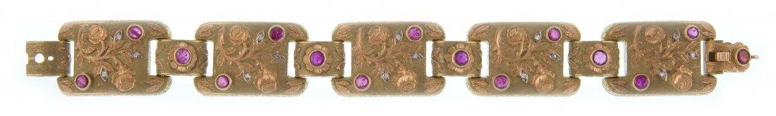 A golden bracelet with rubies by Cazzaniga