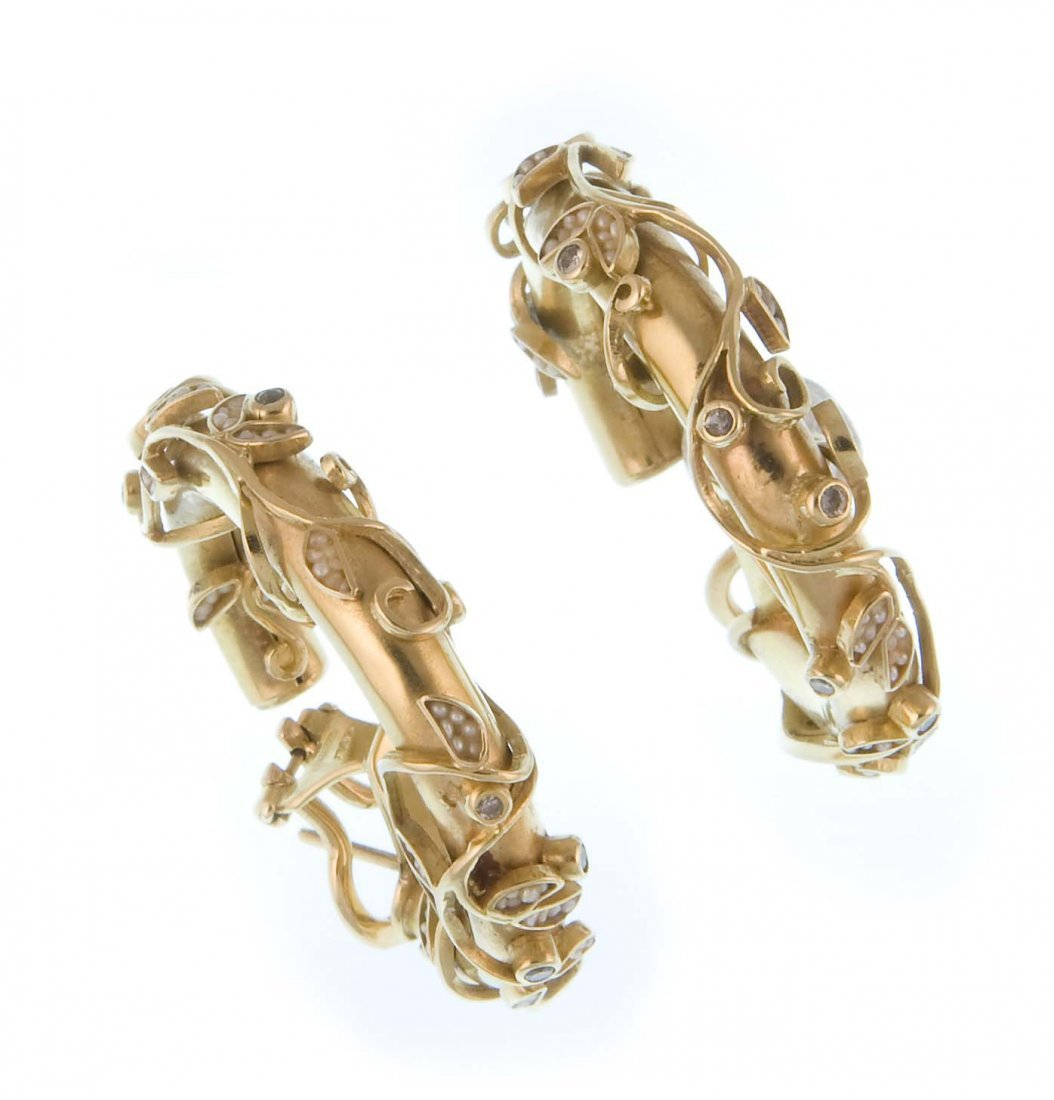 A pair of floral ear hoops