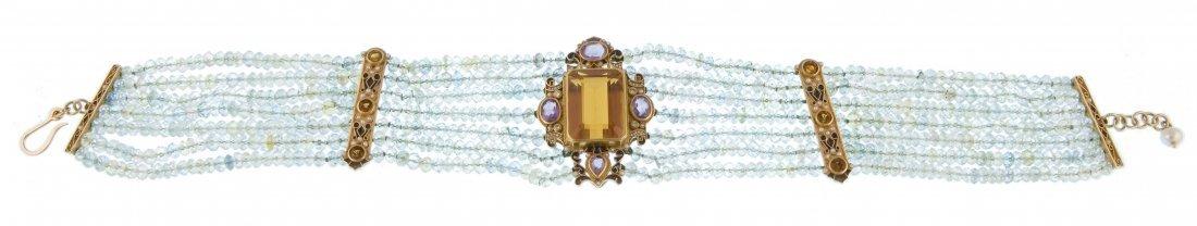 A topaz collar necklace with semi-precious stones