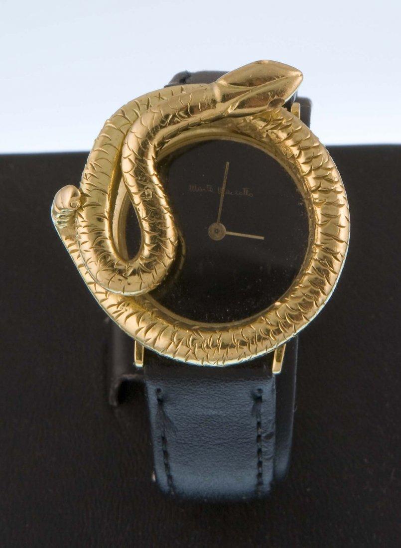 Marta Marzotto, a gold wristwatch