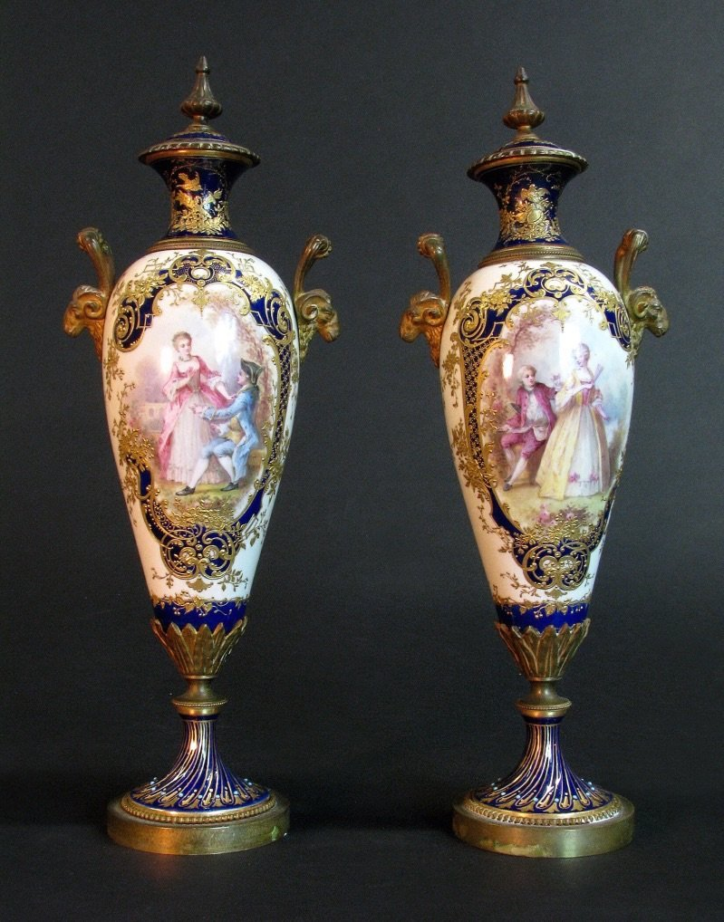 PAIR OF 19TH CENTURY ORMOLU MOUNTED SEVRES VASES