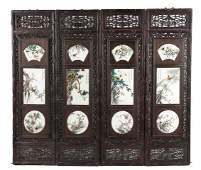 A SET OF FOUR CHINESE PORCELAIN AND HARDWOOD PANELS