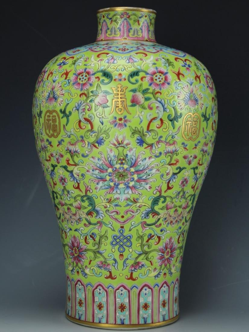 A famille-rose porcelain vase with floral and yellow