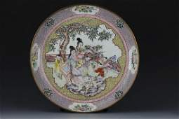 A large Chinese cloisonne plate depicting ladies and