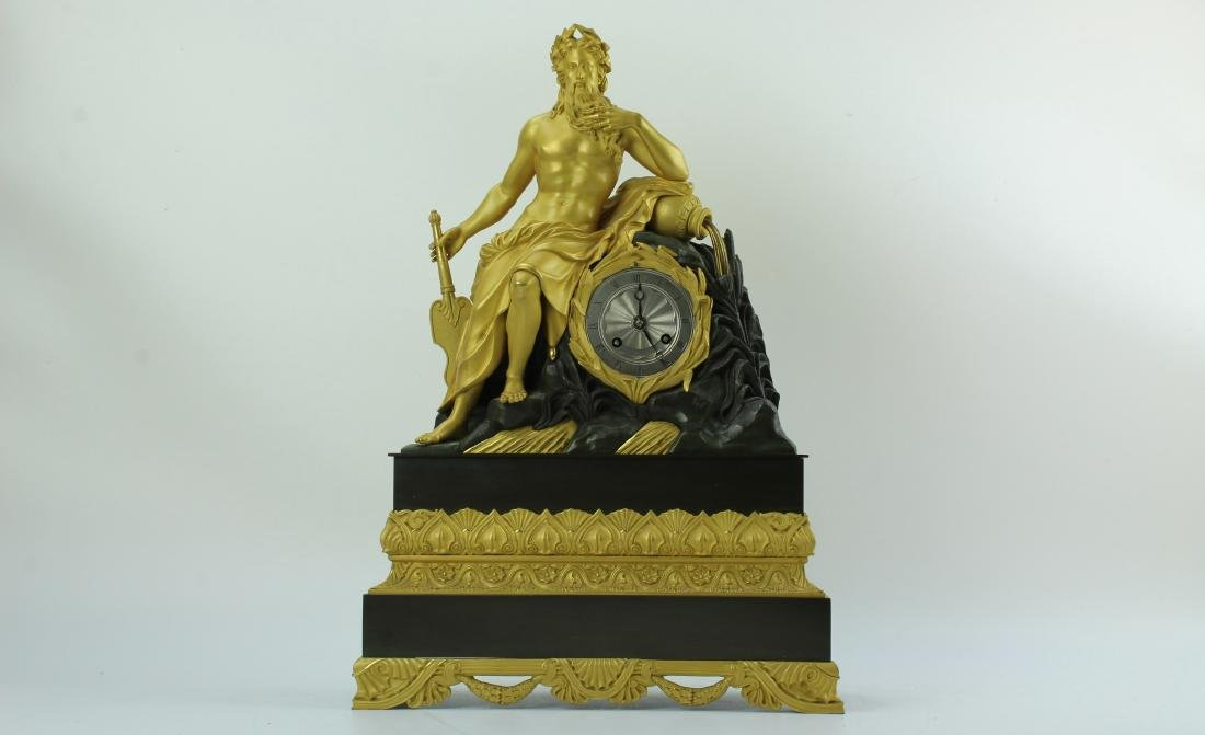 A shiny gilt brass clock with Neptune by Gilleon 1850