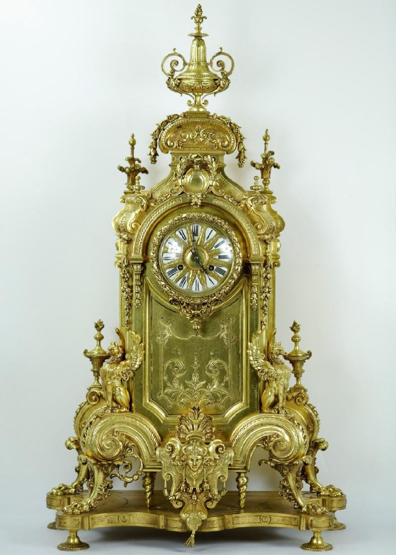 3-pieces Monumental clock with a pair of candelabra
