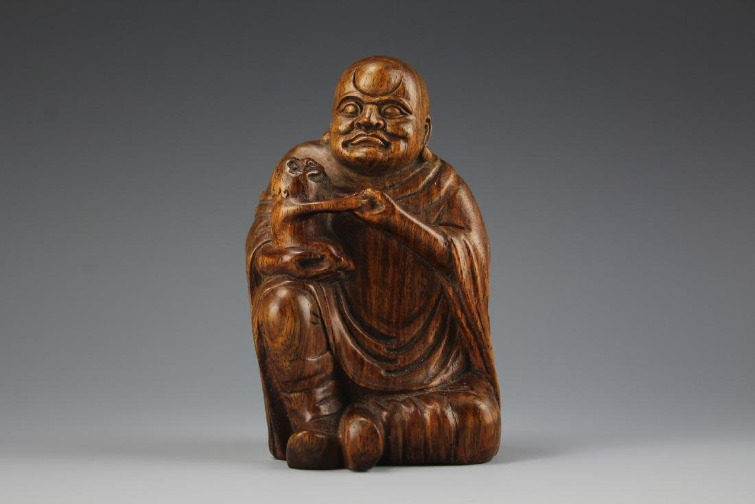 A Carved Rosewood Buddha figure