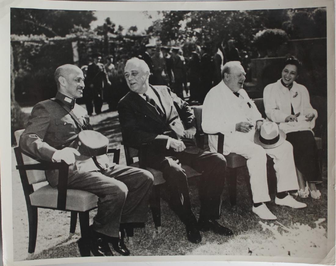 A Photo of Soong May-Ling , Chiangkai-shek, Churchill,