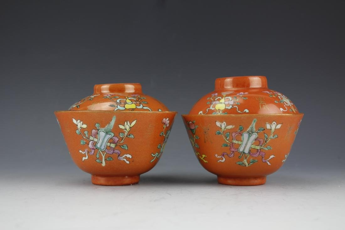 A Pair of Famille Rose Gilt Coral Red Ground Cups and