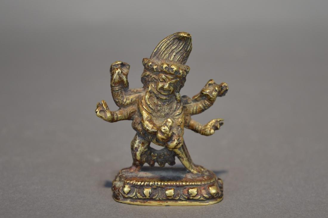 A Gilt Bronze Black Six-Armed Mahakala Guardian Statues