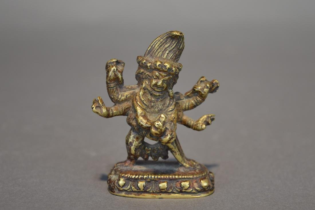 A Gilt Bronze Black Six-Armed Mahakala Guardian Statues