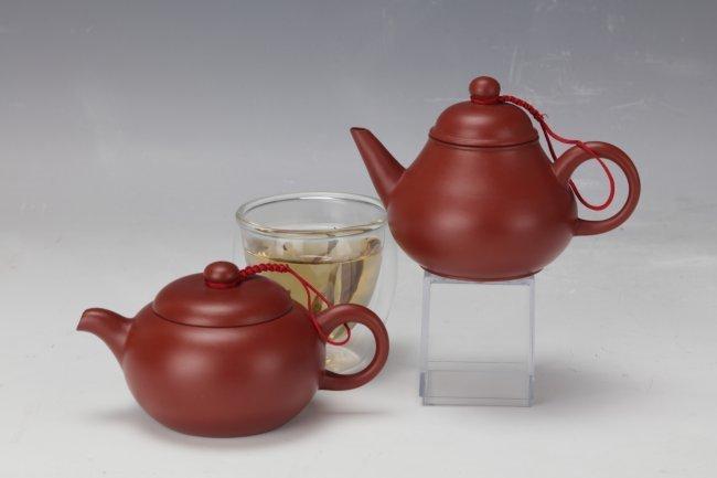 Two  Purple Sand Tea Pots with Huiyigong Mark and