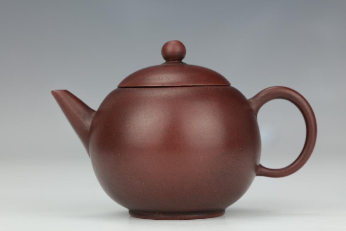 A Purple Sand Tea Pot with Yixing China Mark