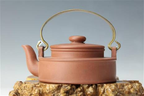 A Purple Sand Tea Pot with Zhouxiaoxian Mark and Yixing