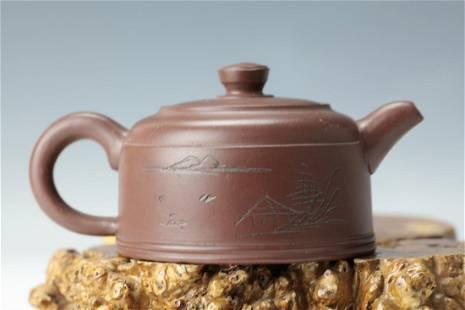 A Purple Sand Tea Pot of landscape and Colligraphys