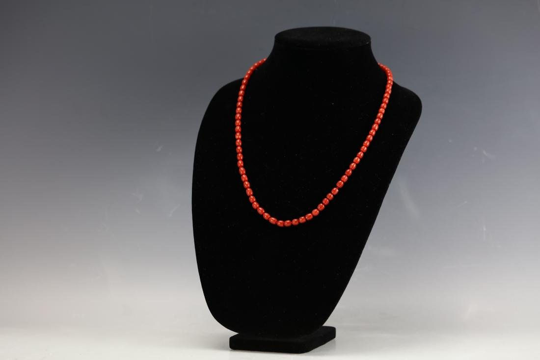 A Red Coral Necklace 23 Inches Long 26 g