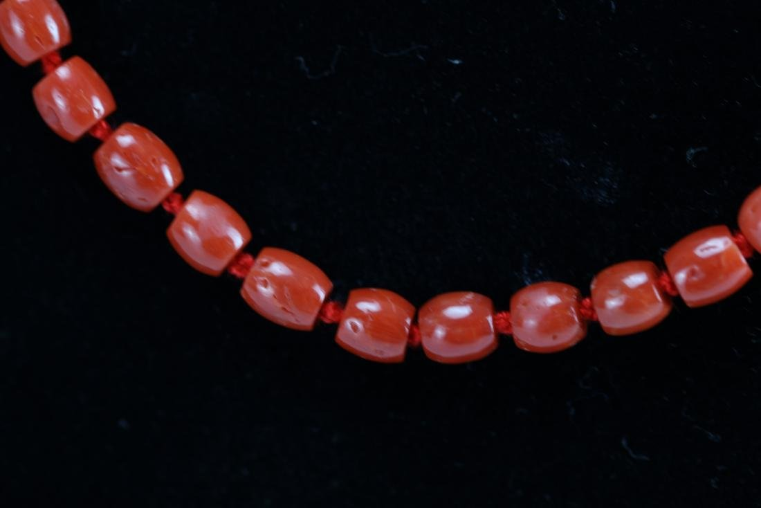 A Red Coral Necklace 23 Inches Long 26 g - 2