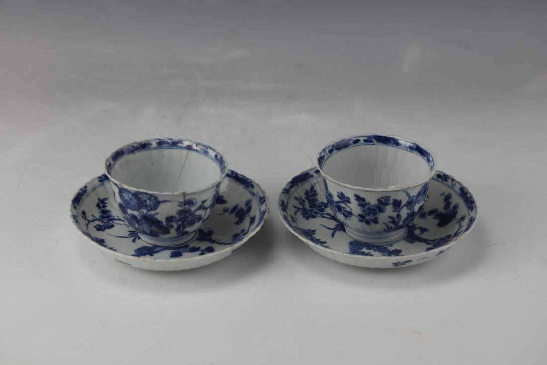 A Pair of Blue and White Tea Cups with Plates