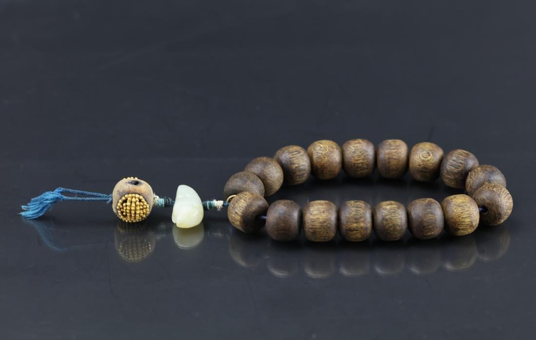 A Chinese Chenxiang Wood Bracelet
