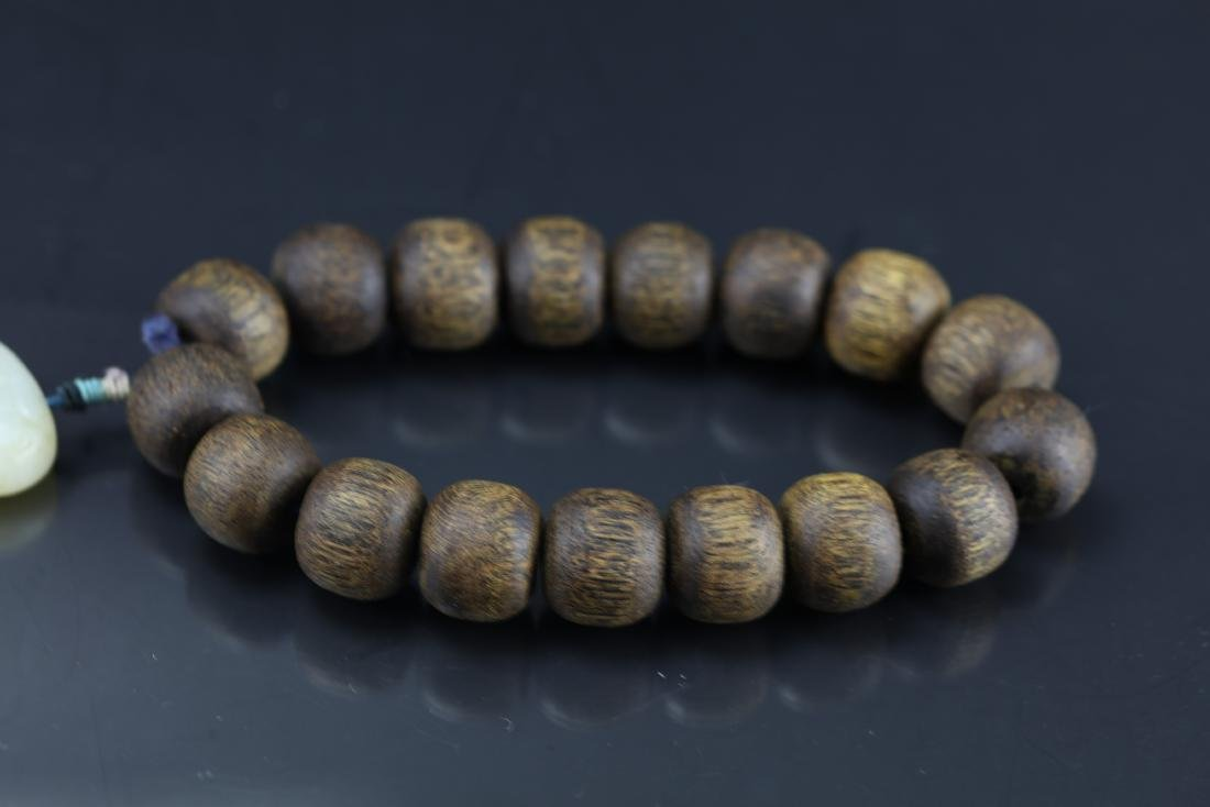 A Chinese Chenxiang Wood Bracelet - 4