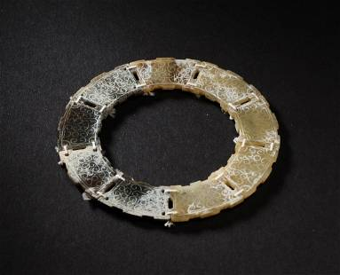 Carved 9 Sectional Jade Ring of Han Dynasty