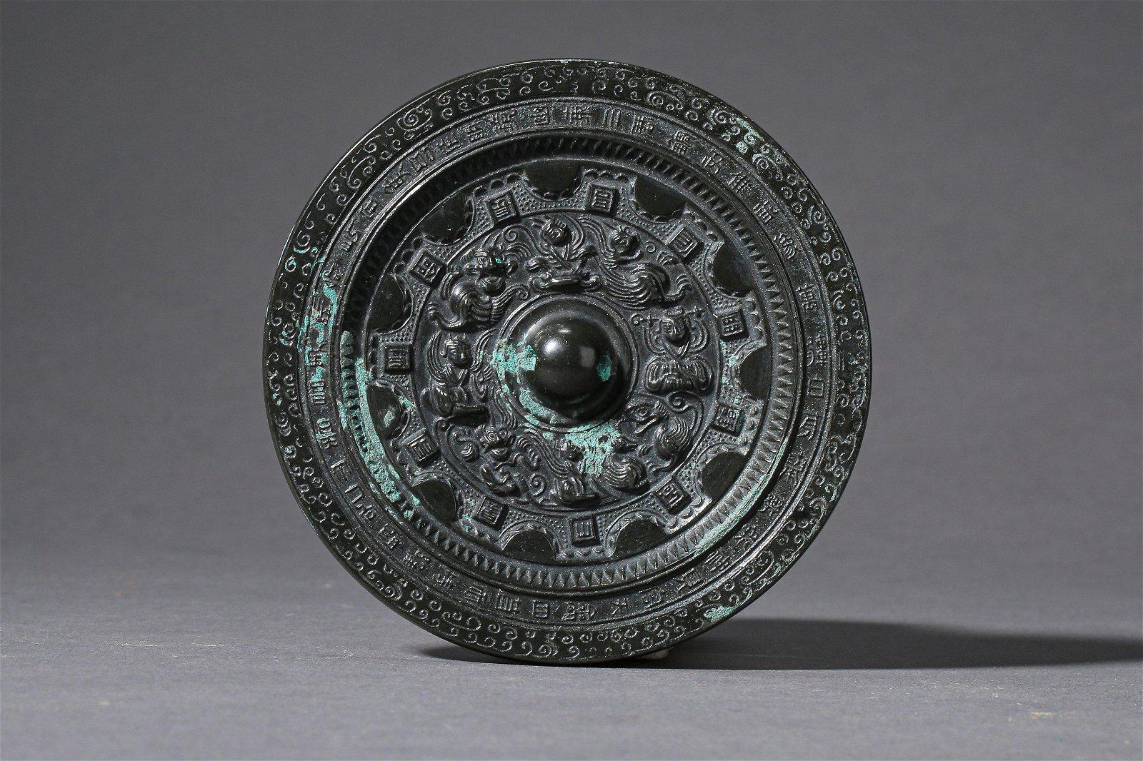 A Chinese Mystical Beast Bronze Mirror Han