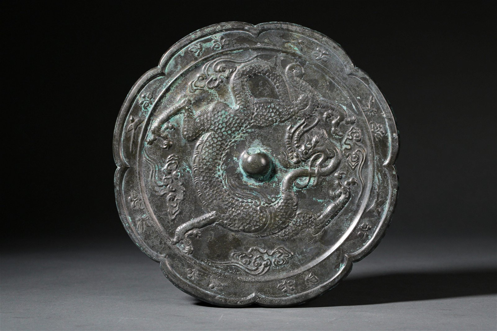 A Chinese Dragon Pattern Bronze Mirror Tang