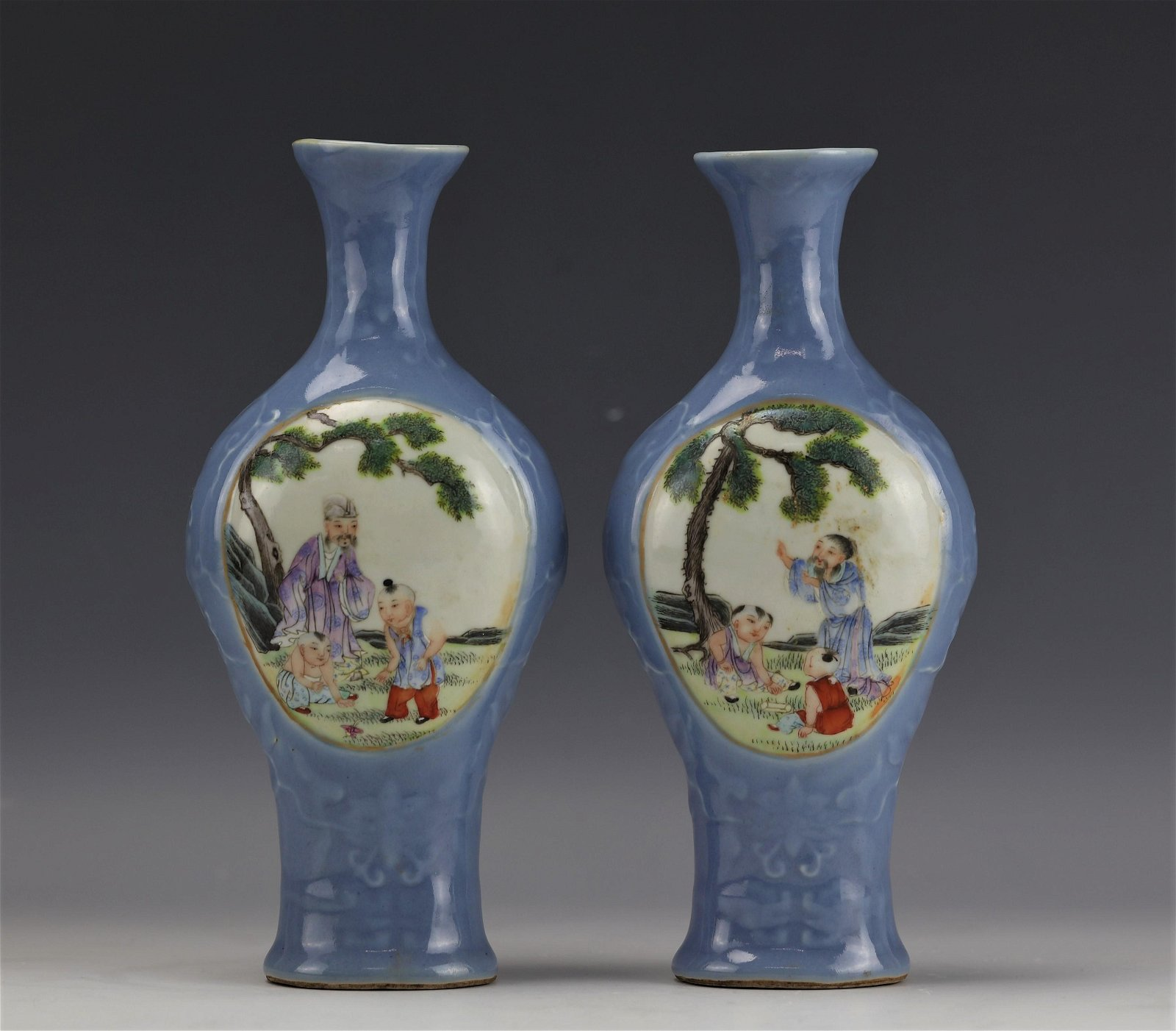 A Pair of Blue Ground Famille Rose Porcelain Vase with
