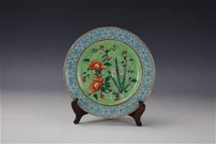 A Qing Dynasty Famille Rose Porcelain Plate with Ji