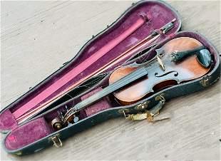 A Vintage Violin with Case