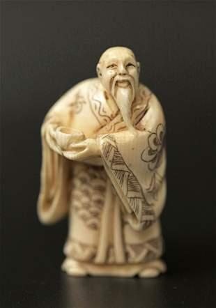 A Netsuke Miniature Carved Bone Sculpture of an Old Man