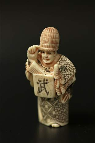 A Netsuke Miniature Carved Bone Sculpture of an