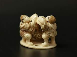 A Netsuke Miniature Carved Bone Sculpture of Three Men