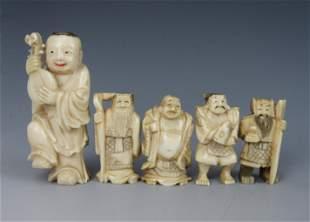 A Group of Netsuke Miniature Carved Bone Figurines
