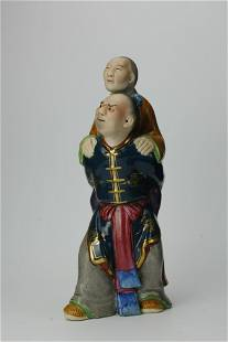 A Chinese Ceramic Figurine of Son Carrying Mother