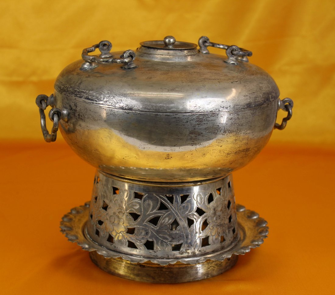 A Chinese Silver Carved Hotpot