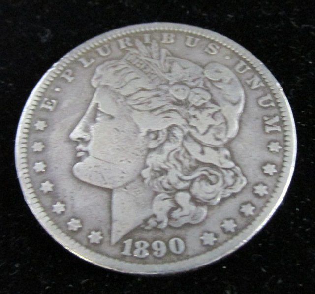 1890 P Morgan Silver Dollar Detail is good but coin has