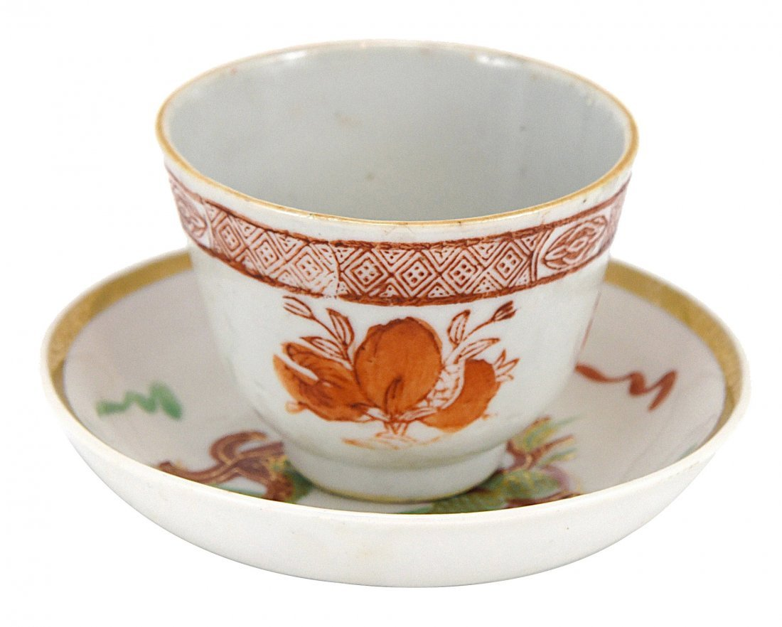 A SAUCER SET WITH GILTED EDGE AND RED TRIMMED