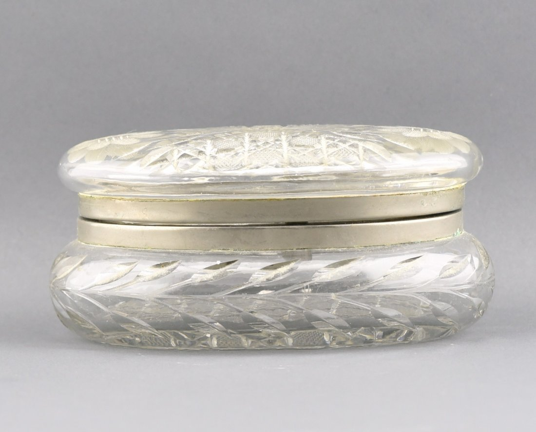 A CRYSTAL BOX INLAID WITH SILVER