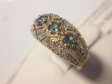 Ladies vintage style diamond and green stone ring