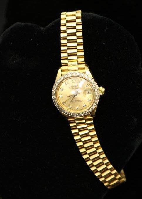 Women's 18kt Rolex watch containing diamonds