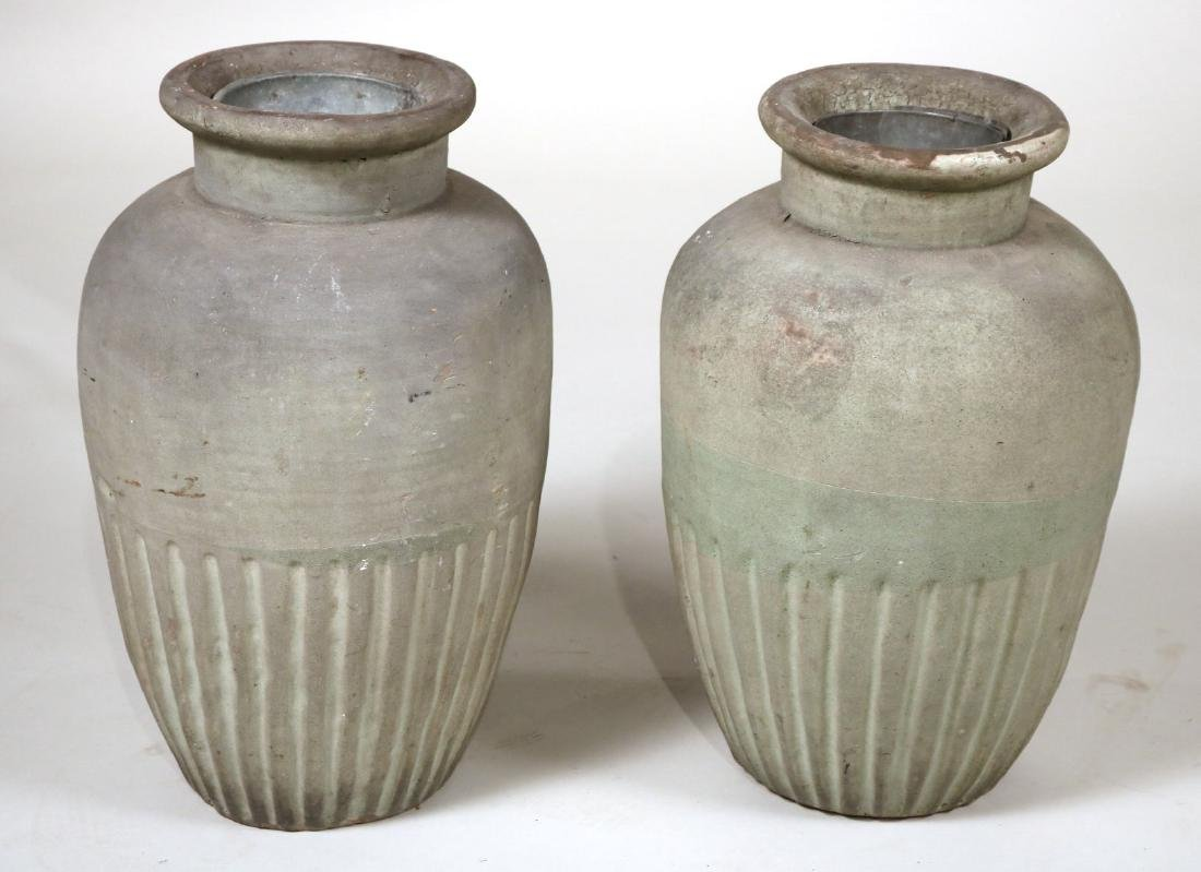 Two Painted Earthenware Garden Urns