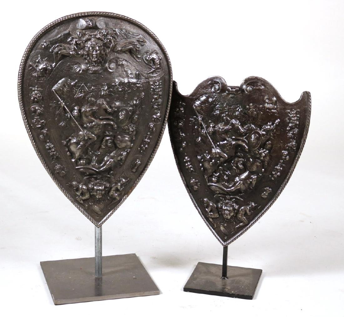Two Polished Cast-Iron Armorial Plaques